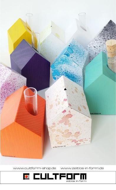 Die Hausbox von Cultform. Ein eindrucksvolles und doch einfaches DIY: kleine Geschenke individuell modern verpacken im aktuellen Watercolor-Trend: farbiges Arrangement mit Cultform-Holz-Häusern,Orange. Gelb, Azur, Lila