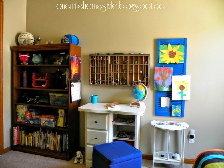 Tan and green kids room - bookcase and desk