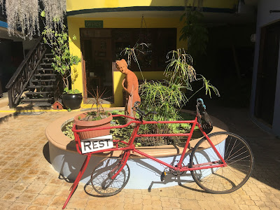 bicycle at the entrance of Idlers rest hotel, Chevy Takes The Mic Jamaican Travel Blog Series Adventures in St. Elizabeth Jamaica, things to do in Jamaica