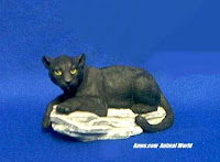 Black Panther Figurine Statue on Rock