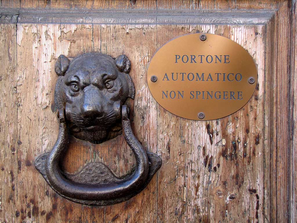 Lionhead, automatic door sign, via Grande, Livorno