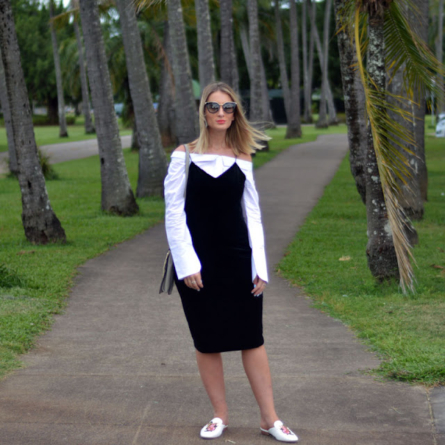 street style blogger look velvet midi dress styled over button up off shoulder white shirt and embroidered mules