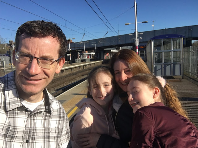 family selfie on platform