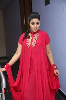 Actress Poorna Latest Stills in Red Dress at Rakshasi First Look Launch  0185.JPG