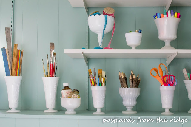 Vintage milk glass is a great way to organize crafting supplies.