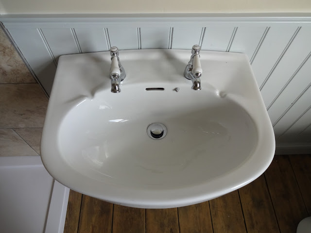 Antonio Basin Taps in Old Sink