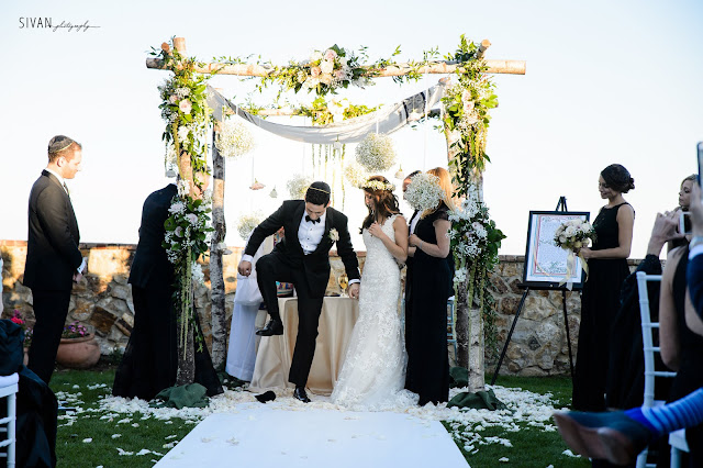 bride and groom breaking glass- mazel tov