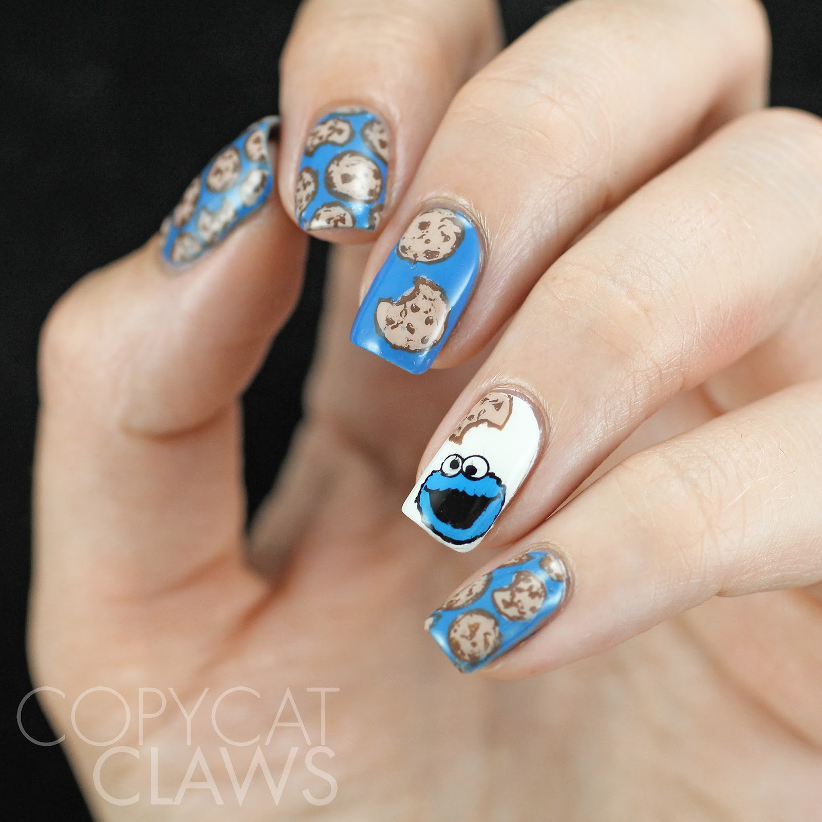Copycat claws the digit al dozen does food day 3 cookies and cookie monster came from fun 11 stamped with mundo de unas black and filled with mundo de unas blue and white all of it was made all shiny with hk girl voltagebd Images