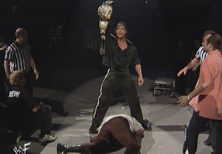 WWE / WWF Royal Rumble 1999 - New WWF Champion The Rock stands over a fallen Mankind