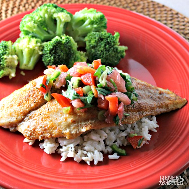 Sweet and Spicy Swai Fillets with Citrus Salsa on a red plate with rice and broccoli