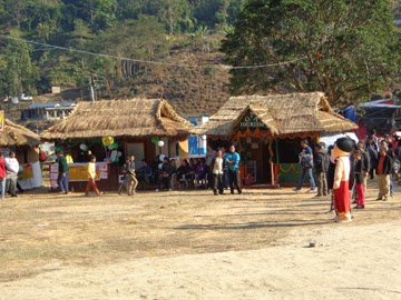 Traditional huts at the Krishi Mela in Jamuney.