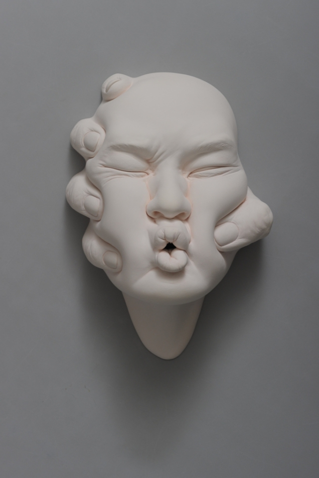 06-Johnson-Tsang-Ceramic-and-Porcelain-Faces-with-Multiple-Expressions-www-designstack-co