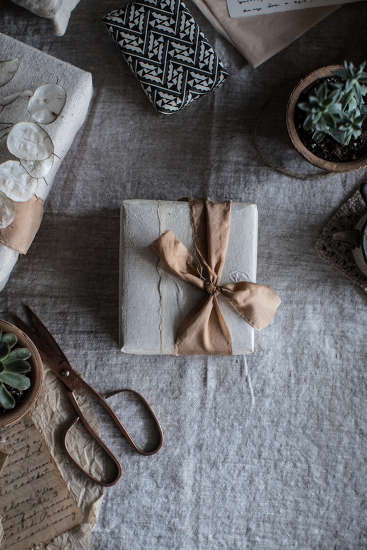 Hand-dyed silk ribbon gift wrapping idea, wabi-sabi christmas decor, unrefined luxury christmas decor, beautiful christmas gift wrapping idea. Photo via Local Milk