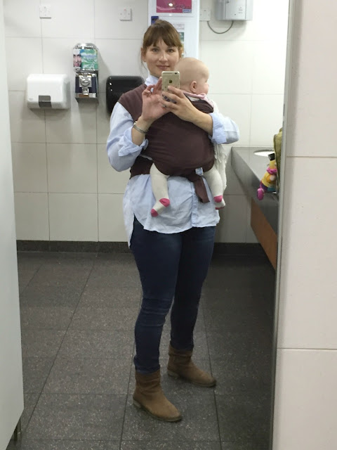 Tin Box Traveller wearing baby in a sling