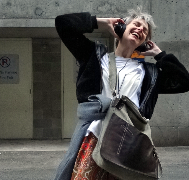 Mel Kobayashi of Bag and a Beret acting like a dork with her headphones in a Vancouver alley. Mix tapes are all that.