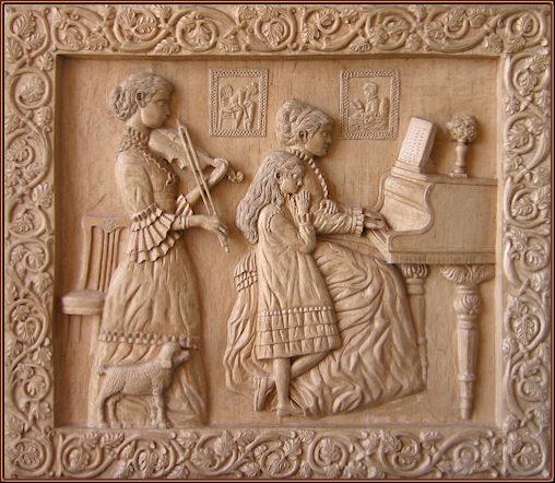 Velada musical. Talla en madera