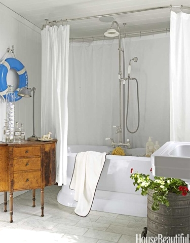 Nautical bathroom design Idea with life preserver wall hanging