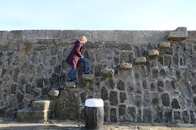 Rachel Knowles walking up the steps on the Cobb, Lyme Regis (2016)