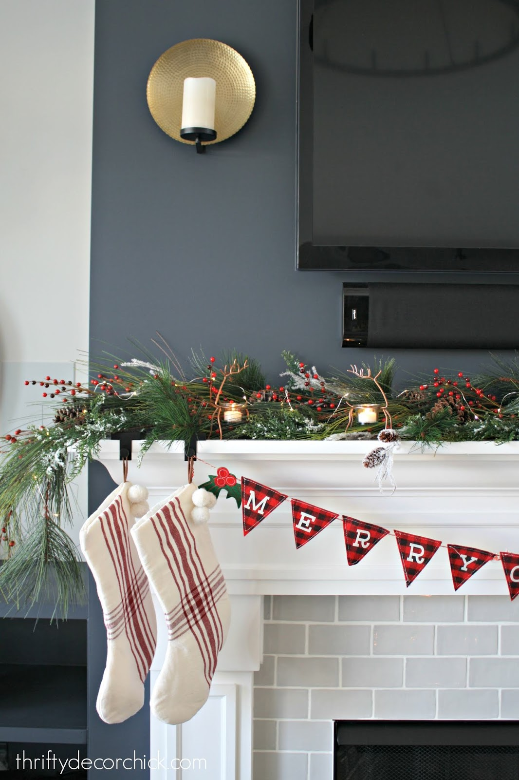 Faux greenery with berries on mantel