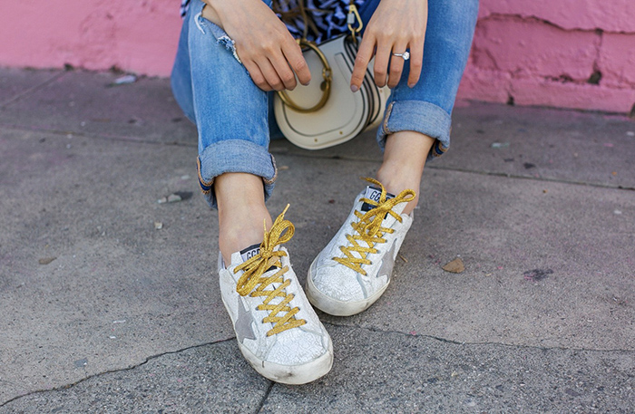 Golden goose super star sneakers, asos stripe top, chloe carlina sunglasses, chloe nile bag, blank nyc distressed jeans, travel outfit ideas, san francissco fashion blog, la lan land street style