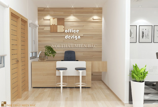 Thiết kế nội thất văn phòng chuyên nghiệp không gian lễ tân nhỏ với chiếc bàn quầy bằng gỗ và chiếc ghế xoay bọc da dành cho nhân viên bộ phần lễ tâ