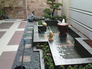 Kolam koi, kolam minimalis,Tukang taman Surabaya, desain taman Surabaya,waterwall, waterfall, Ampyangan, Carport, batu kerikil  karpotan,  jasa taman, taman kering, taman minimalis, Ornamen, Pahatan