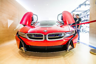 The BMW i8 protonic red exterior finish Qatar Motor Show 2017
