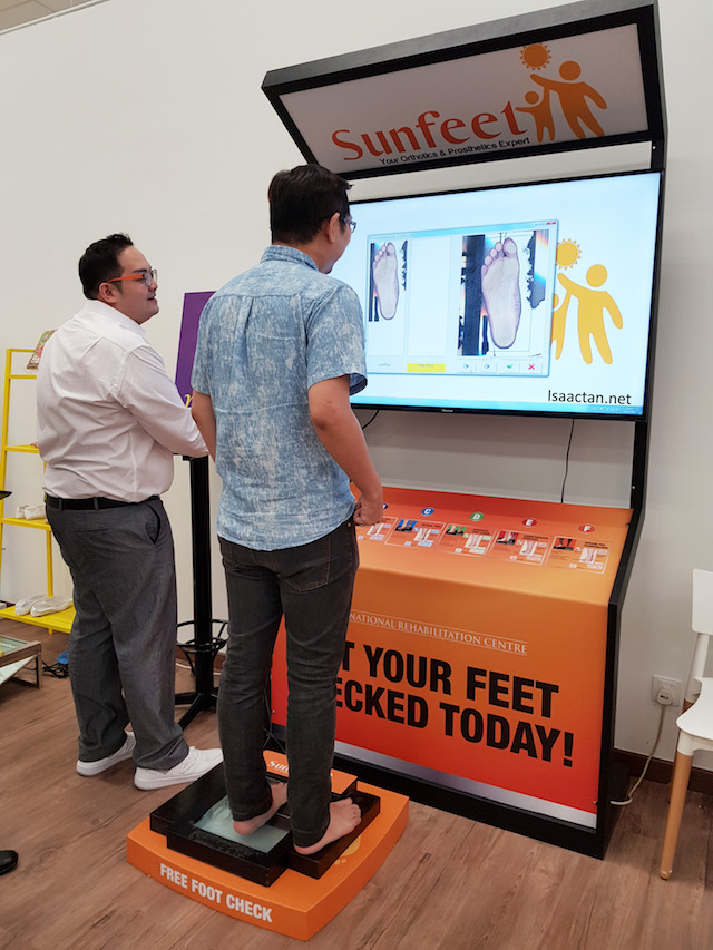 "Getting my feet checked, notice my ""flat foot"" scanned image on the screen"