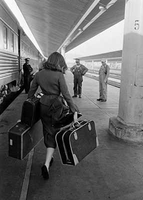 http://tamburina.tumblr.com/post/35695348365/allan-grant-woman-disembarking-a-train-1950s