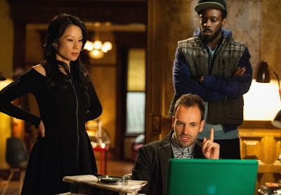 Jonny Lee Miller as Sherlock Holmes, Lucy Liu as Joan Watson and Ato Essandoh as Alfredo Llamosa in CBS Elementary Episode # 20 Dead Man's Switch