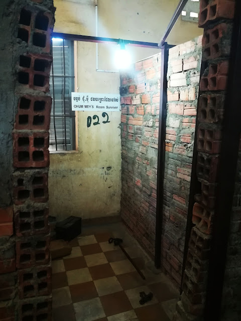 This is what a cell looked like. This particular cell belonged to one of the 7 survivors of the prison. There are rows of such cells in the rooms.