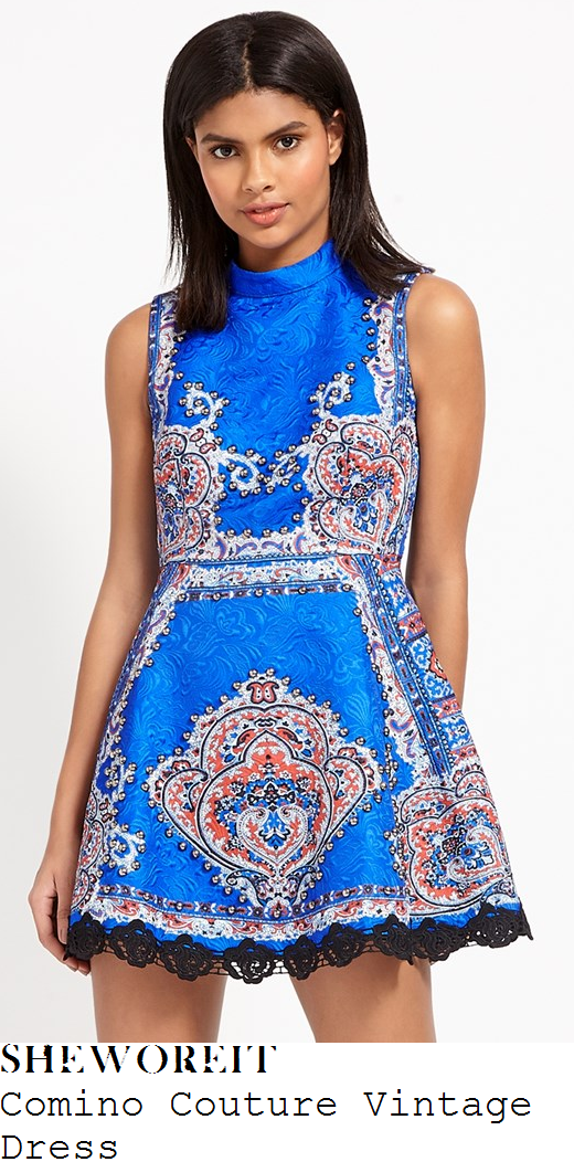 megan-mckenna-comino-couture-vintage-electric-blue-white-black-and-orange-folk-scarf-print-sleeveless-high-neck-stud-embellished-lace-trim-detail-structured-a-line-mini-dress