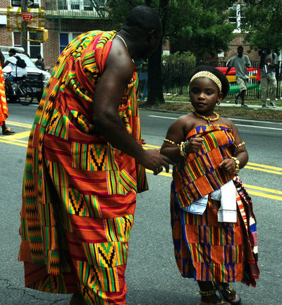 Ashanti man and her daughter wearing Kente in London