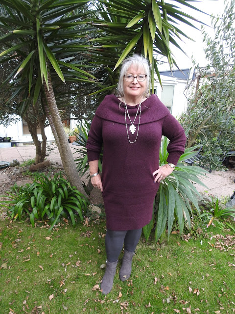 Mary the blogger from The Pouting Pensioner in berry shades and grey boots