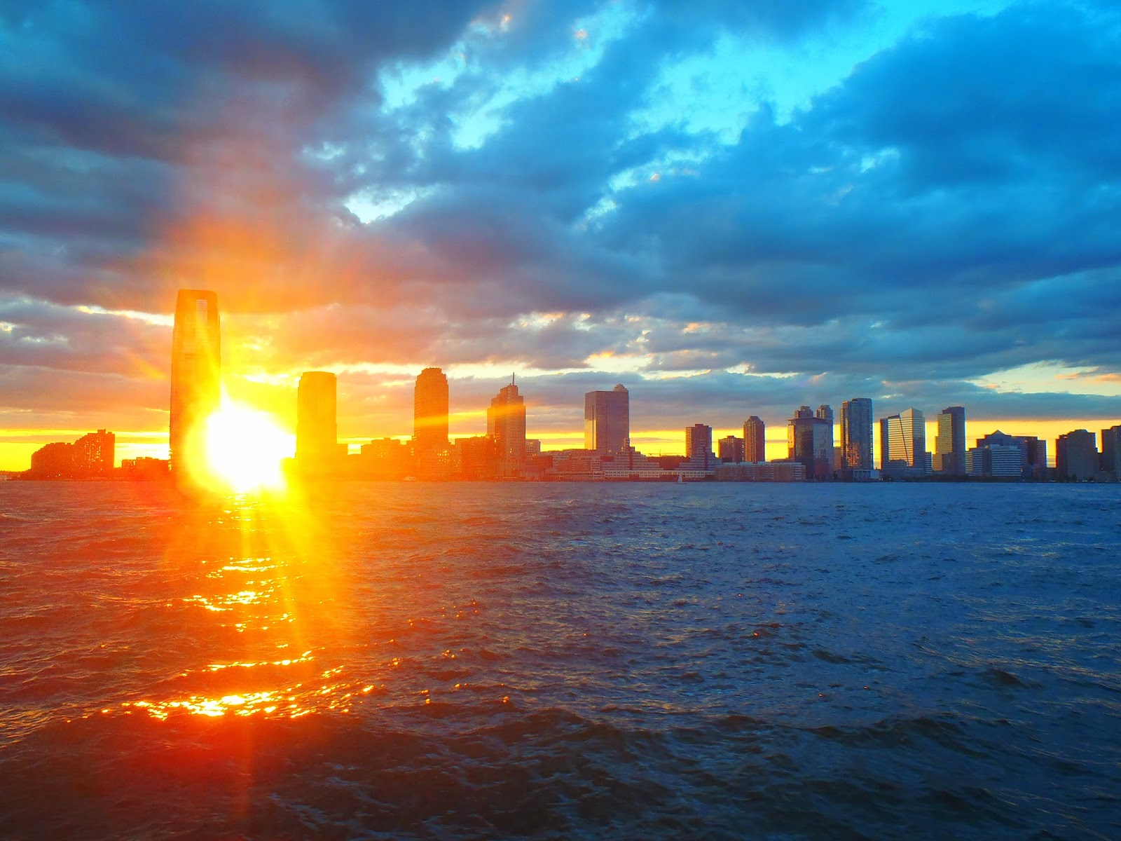 the sun dipping between the buildings in New York