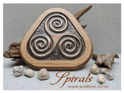 Triple Spiral wall plaque in bronze and oak from Justbod