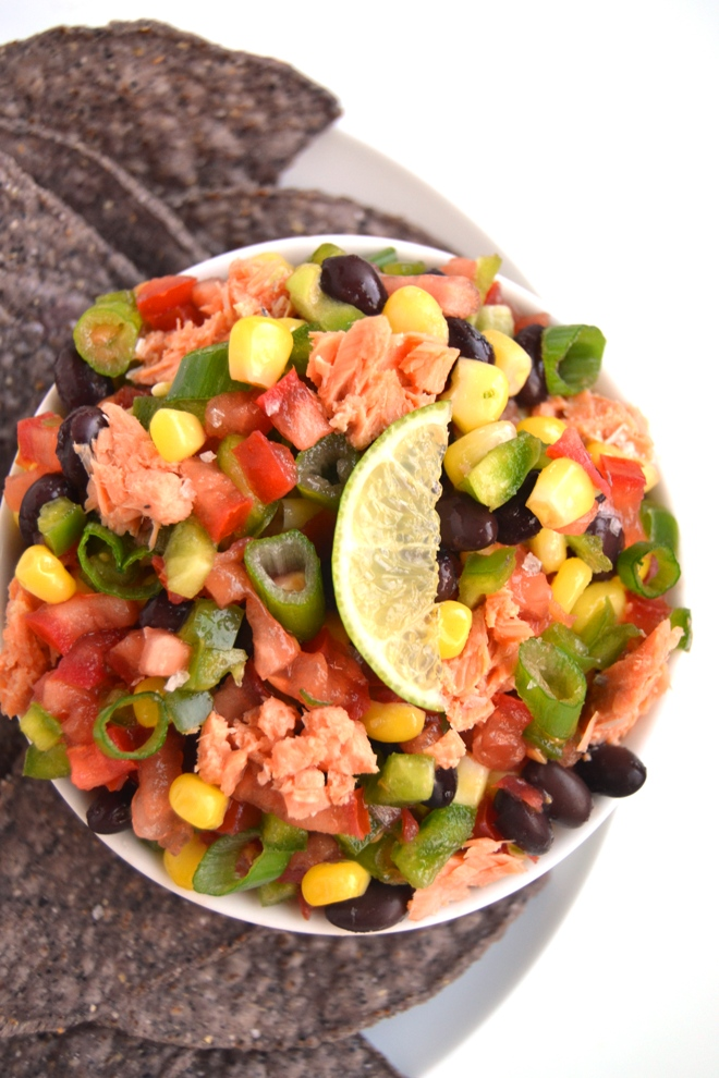 Salmon Texas Caviar is a delicious black bean, tomato, corn and bell pepper salad with salmon and a tangy lime vinaigrette. Serve as a salad or as an appetizer with tortilla chips! www.nutritionistreviews.com