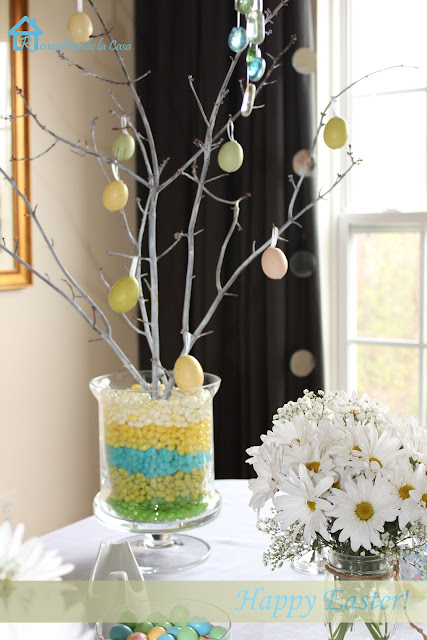 Easter egg tree with tree branches in a multicolored Jelly bean vase.