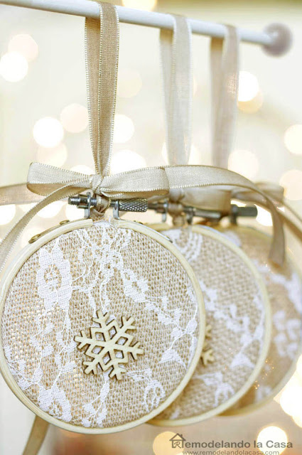 natural look with embroidery fabric an wooden snowflake ornament with lights on the background