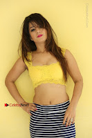 Cute Telugu Actress Shunaya Solanki High Definition Spicy Pos in Yellow Top and Skirt  0513.JPG