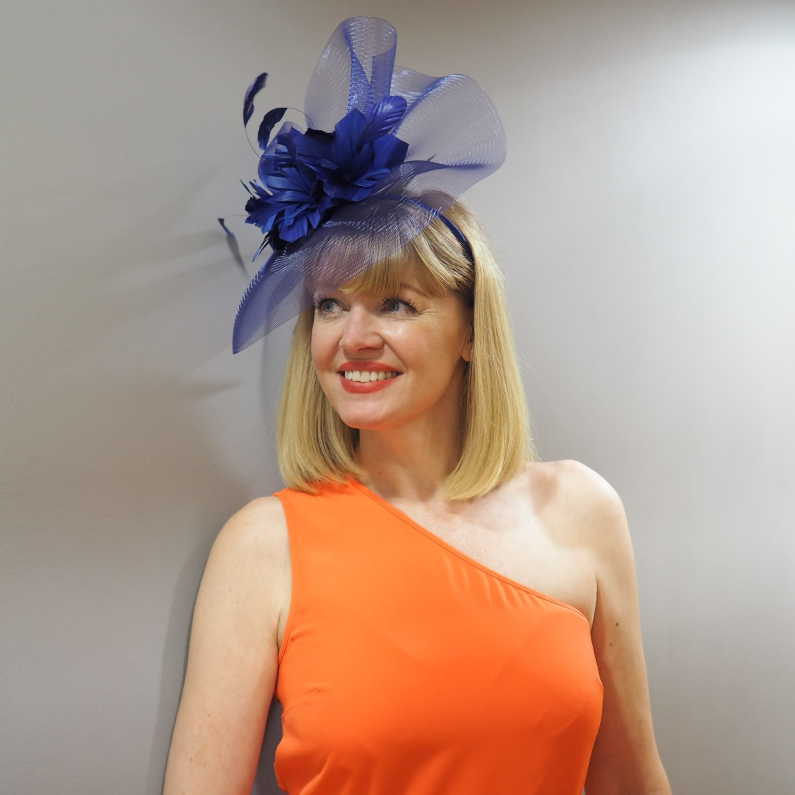 What to wear for York Races, Dorothy Perkins cobalt fascinator, Warehouse orange one shoulder dress, over 40