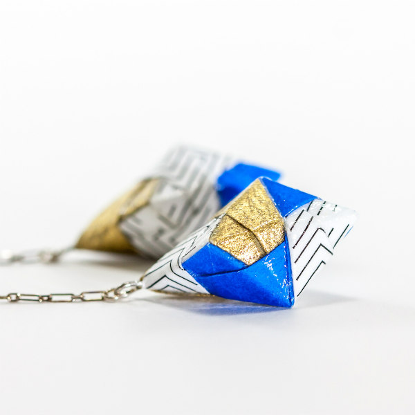 gold, blue, black, and white geometric origami earrings