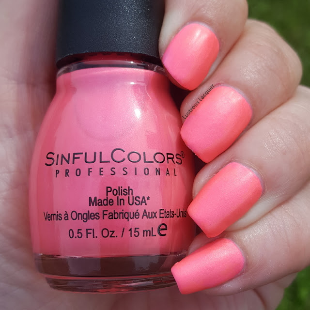 Eye searing neon pink nail polish with peach shimmer in a matte finish