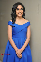Actress Ritu Varma Pos in Blue Short Dress at Keshava Telugu Movie Audio Launch .COM 0014.jpg