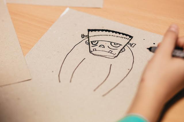 A Frankenstein monster being drawn by a child