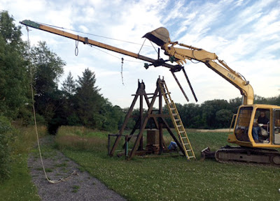 Boris undergoing repairs. The trebuchet at Our Farm needed to have its throwing arm replaced after it cracked.