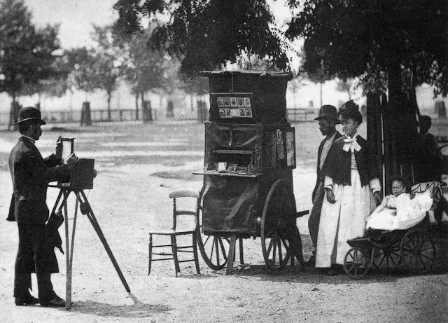 A family posing to take photographs, 1873