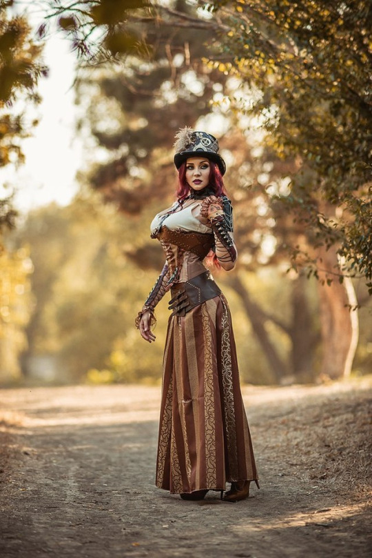 steampunk girl wearing sexy gauntlets, corset, tank top, hat, skirt, belt, and heels. Women's steampunk clothing and fashion.