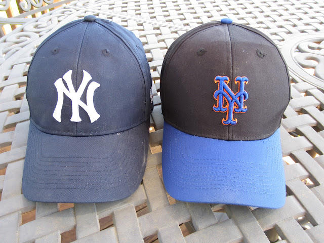 Yankee and Met hats