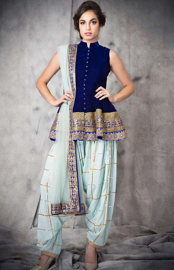 359db2459d Dhoti pants have a relaxed fit and the pleats in these voluminous bottoms  are best flaunted with a short kurti. Go for a peplum style super sort  anarkali ...